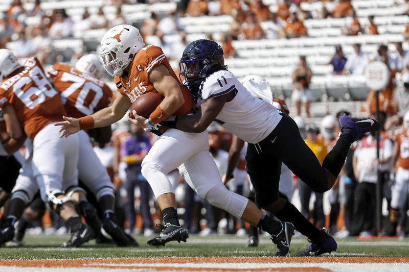 Khari Coleman #11 of the TCU Horned Frogs tackles Sam Ehlinger #11 of the Texas Longhorns near the goal line on Oct. 3. (Tim Warner/Getty Images)
