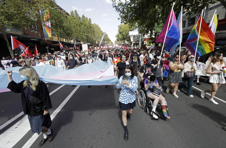 Hundreds of protesters march in Sydney, Saturday, March 6, 2021, ahead of the annual Gay and Lesbian Mardi Gras. The protesters say they want to restore the protest roots of Mardi Gras and challenge systems of injustice. (AP Photo/Rick Rycroft)