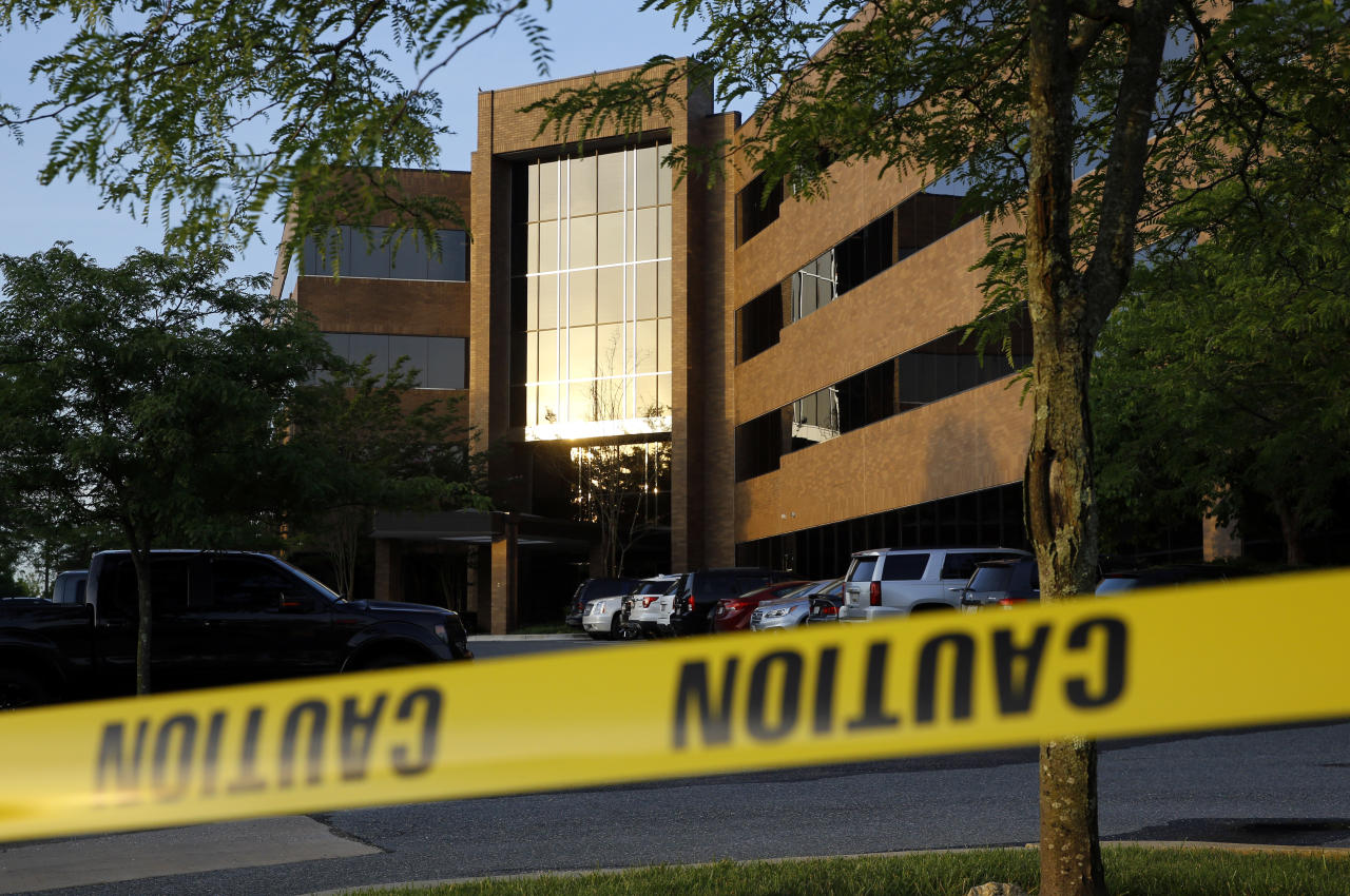 <p>Crime scene tape surrounds a building housing The Capital Gazette newspaper's offices, Friday, June 29, 2018, in Annapolis, Md. A man armed with smoke grenades and a shotgun attacked journalists in the building Thursday, killing several people before police quickly stormed the building and arrested him, police and witnesses said. (Photo: Patrick Semansky/AP) </p>