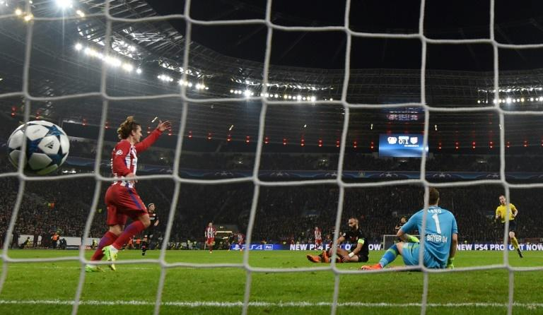 Atletico Madrid's Antoine scores a goal past Leverkusen's goalkeeper Bernd Leno during their UEFA Champions League round of 16 1st-leg match, in Leverkusen, on February 21, 2017