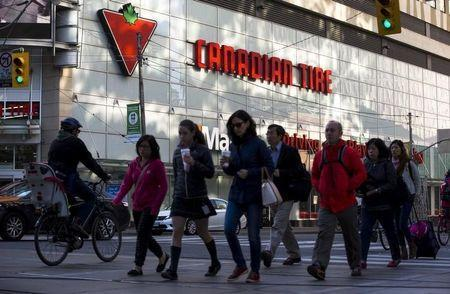 People walk by a Canadian Tire Store in downtown Toronto, May 14, 2015. REUTERS/Mark Blinch