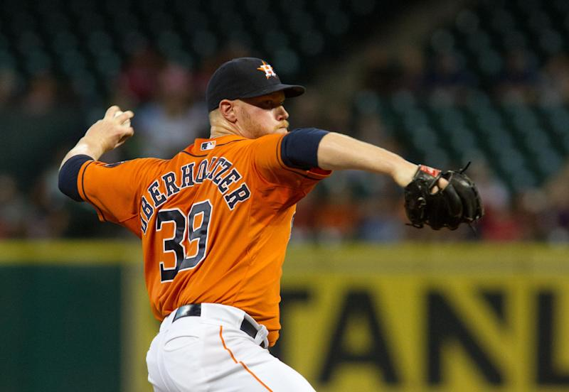 Houston Astros' Brett Oberholtzer delivers a pitch against the Texas Rangers in the first inning of a baseball game Friday, Aug. 29, 2014, in Houston. (AP Photo/Richard Carson)