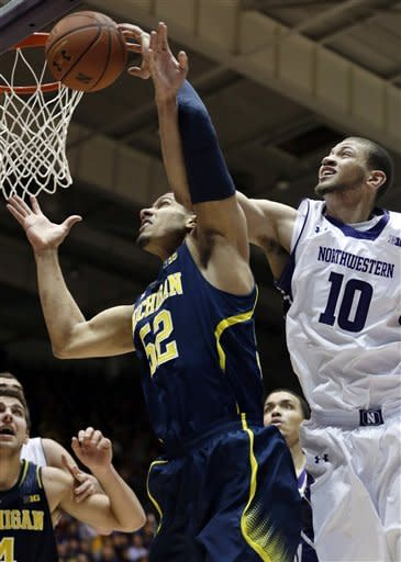 Michigan forward Jordan Morgan, left, and Northwestern forward Mike Turner battle for a rebound during the first half of an NCAA college basketball game in Evanston, Ill., Thursday, Jan. 3, 2013. (AP Photo/Nam Y. Huh)