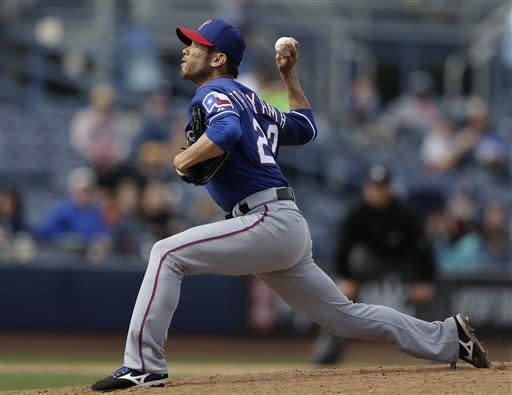 Texas Rangers relief pitcher Yoshinori Tateyama, of Japan, throws against the San Diego Padres during the fifth inning in an exhibition spring training baseball game on Saturday, March 9, 2013, in Peoria, Ariz. (AP Photo/Gregory Bull)