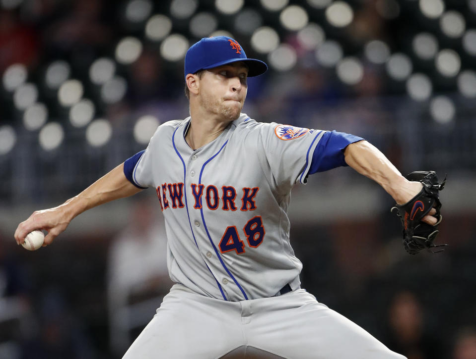 New York Mets starting pitcher Jacob deGrom (48) delivers in the ninth inning of a baseball game against the Atlanta Braves Tuesday, June 18, 2019, in Atlanta. New York won 10-2. (AP Photo/John Bazemore)