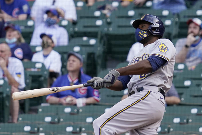Milwaukee Brewers' Lorenzo Cain watches after hitting a three-run home run against the Chicago Cubs during the 10th inning of a baseball game in Chicago, Wednesday, April 7, 2021. (AP Photo/Nam Y. Huh)
