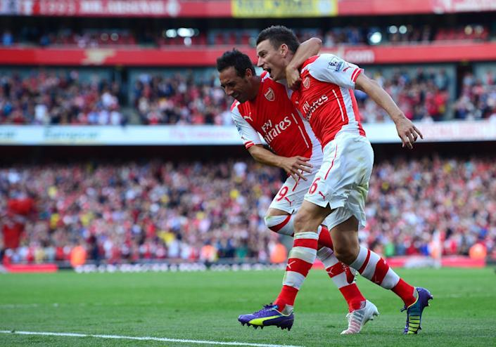 Arsenal's defender Laurent Koscielny (R) celebrates after scoring the equalising goal with Arsenal's midfielder Santi Cazorla during the English Premier League football match on August 16, 2014 (AFP Photo/Carl Court )