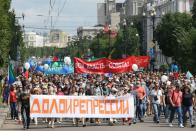 People take part in a rally in support of former regional governor Sergei Furgal in Khabarovsk
