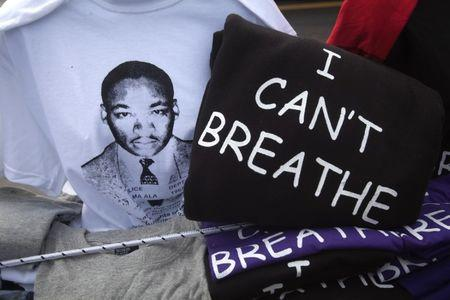 "T-shirts with the image of Martin Luther King and with the words ""I can't breathe"" are pictured for sale during a Martin Luther King day rally in the Harlem section of New York January 19, 2015.           REUTERS/Carlo Allegri"