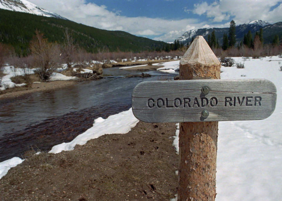 FILE - In this Thursday, May 1, 1997, file photograph, a sign marks the Colorado River as it flows past the Never Summer Mountains in Rocky Mountain National Park near the town of Grand Lake, Colo. The U.S. Department of Energy on Tuesday, Aug. 24, 2021, announced a new kind of climate observatory near the headwaters of the Colorado River that will help scientists better predict rain and snowfall in the U.S. West and determine how much of it will flow through the region. (AP Photo/David Zalubowski, File)