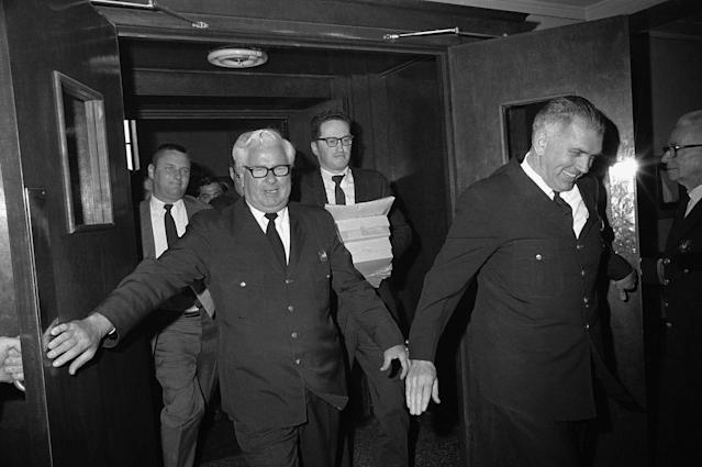 <p>Two court officers push open doors for newsmen, who rush out of Superior Court, April 30, 1970 in Boston, with copies of the Kopechne inquest court record and Judge James A. Boyle's 12- page report. Mary Jo Kopechne died in a car accident on Chappaquiddick Island last July 18. Sen. Edward Kennedy was the driver of the car. ( \Photo: A.E. Maloof/AP) </p>
