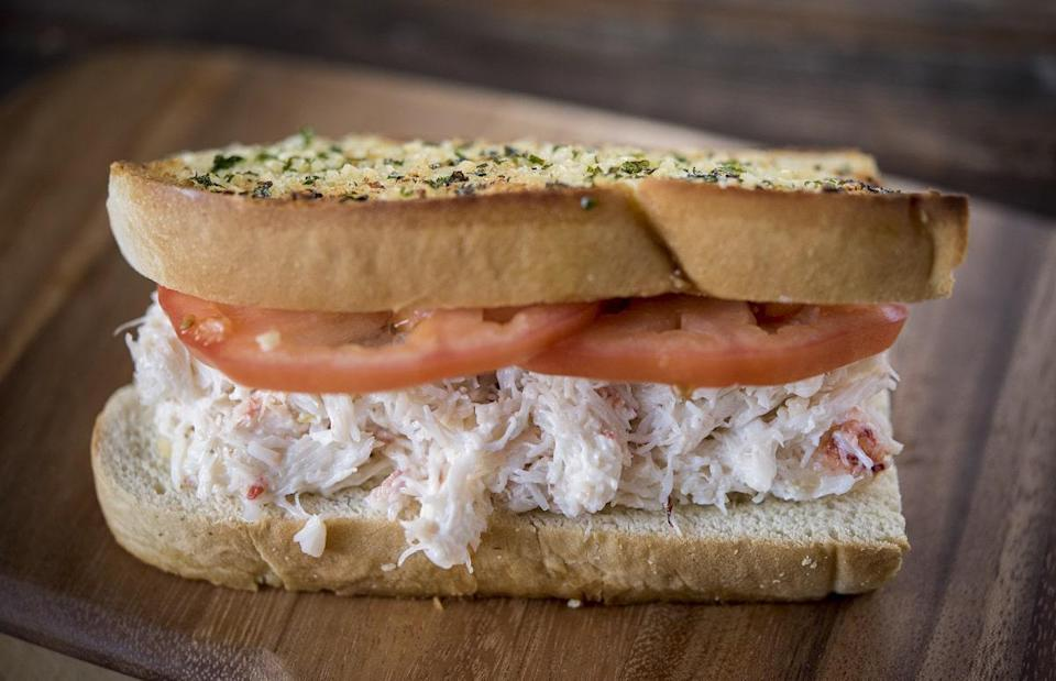 """<p>Just looking at a picture of this dungeness crab sandwich will make your stomach grumble. But don't let its impressive appearance fool you, it's actually super easy to make.</p> <p><a href=""""https://www.thedailymeal.com/recipes/dungeness-crab-sandwich-recipe?referrer=yahoo&category=beauty_food&include_utm=1&utm_medium=referral&utm_source=yahoo&utm_campaign=feed"""" rel=""""nofollow noopener"""" target=""""_blank"""" data-ylk=""""slk:For the Dungeness Crab Sandwich recipe, click here."""" class=""""link rapid-noclick-resp"""">For the Dungeness Crab Sandwich recipe, click here.</a></p>"""