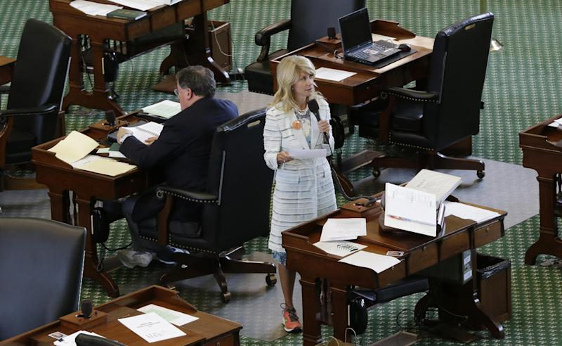 Sen. Wendy Davis, D-Fort Worth, stands on a near empty senate floor as she filibusters in an effort to kill an abortion bill, Tuesday, June 25, 2013, in Austin, Texas. The bill would ban abortion after 20 weeks of pregnancy and force many clinics that perform the procedure to upgrade their facilities and be classified as ambulatory surgical centers. (AP Photo/Eric Gay)