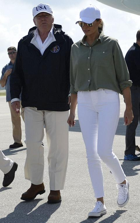 Melania Trump had swapped ballet pumps for trainers by the time she was pictured arriving at Fort Myers with her husband, Donald - Credit: BRENDAN SMIALOWSKI/AFP