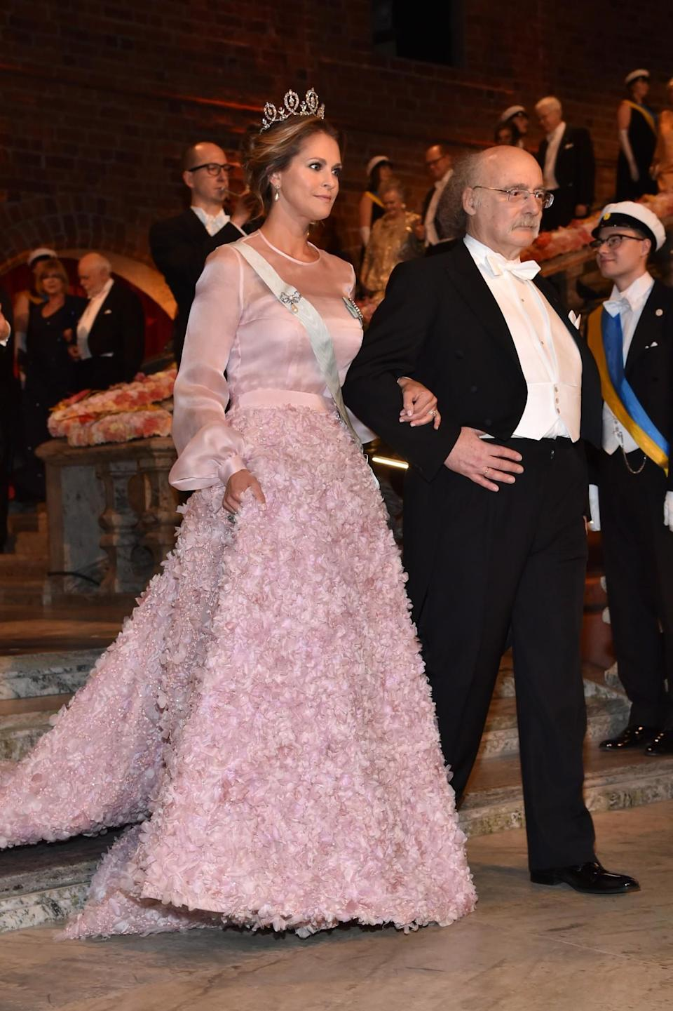 <p>Madeleine is classic with a twist. Known for her love of princess-style gowns, she always adds an unexpected fabric or embellishment to what would be a simple style. The royal has also been spotted in an on-trend puffer jacket. <i>[Photo: Getty]</i> </p>