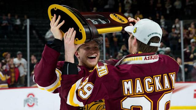 "Jade Miller of the <a class=""link rapid-noclick-resp"" href=""/ncaaf/teams/minnesota_duluth"" data-ylk=""slk:Minnesota Duluth Bulldogs"">Minnesota Duluth Bulldogs</a> celebrates with teammate Parker Mackay after winning the national championship against the <a class=""link rapid-noclick-resp"" href=""/ncaab/teams/nbf"" data-ylk=""slk:Notre Dame Fighting Irish"">Notre Dame Fighting Irish</a>. (Photo by Richard T Gagnon/Getty Images)"