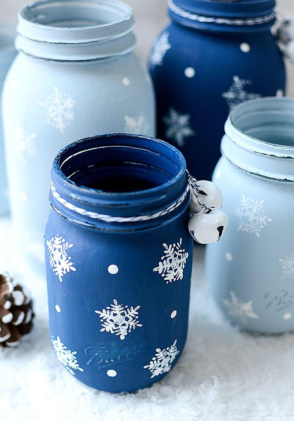 """<p>You can use these painted Mason jars as flower vases throughout the winter to bring a touch of color to your home. </p><p><strong>Get the tutorial at <a href=""""http://www.itallstartedwithpaint.com/snowflake-mason-jars/"""" rel=""""nofollow noopener"""" target=""""_blank"""" data-ylk=""""slk:It All Started With Paint"""" class=""""link rapid-noclick-resp"""">It All Started With Paint</a>. </strong></p><p><a class=""""link rapid-noclick-resp"""" href=""""https://www.amazon.com/ADC-21-Americana-Chalky-Finish-8-Ounce/dp/B00HQKCPVO/?tag=syn-yahoo-20&ascsubtag=%5Bartid%7C10050.g.2132%5Bsrc%7Cyahoo-us"""" rel=""""nofollow noopener"""" target=""""_blank"""" data-ylk=""""slk:SHOP CHALK PAINT"""">SHOP CHALK PAINT</a></p>"""