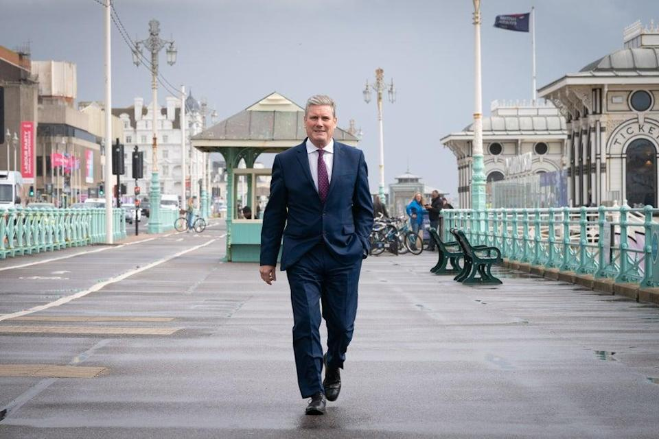 Labour leader Sir Keir Starmer walks along Brighton seafront promenade during the Labour Party conference (Stefan Rousseau/PA) (PA Wire)