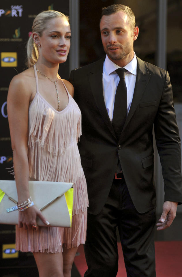 FILE - This Nov. 4, 2012 file photo shows Oscar Pistorius and Reeva Steenkamp at an awards ceremony in Johannesburg, South Africa. Far from the courtroom drama that has gripped South Africa, the family of Pistorius' slain girlfriend, Steenkamp, has struggled with its own private deluge of grief, frustration and bewilderment. The victim's relatives also harbor misgivings about efforts by the Olympian's family to reach out to them with condolences. Pistorius, meanwhile, spent Saturday, Feb. 23, 2013 at his uncle's home in an affluent suburb of Pretoria, the South African capital, after a judge released him on bail. (AP Photo/City Press, Lucky Nxumalo) SOUTH AFRICA OUT
