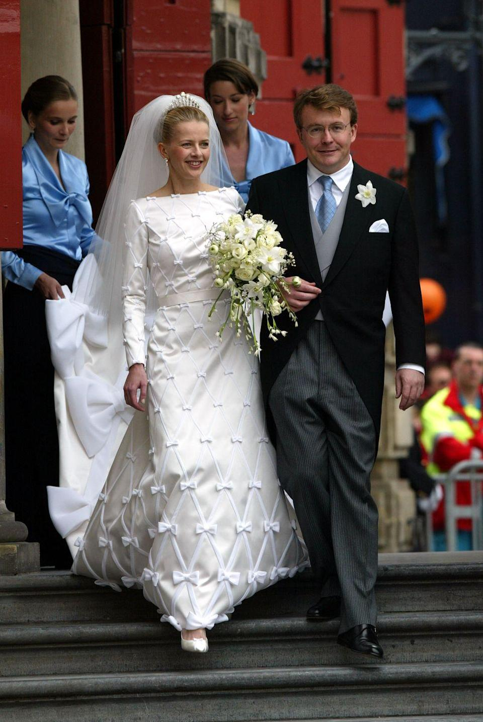 <p>Mabel Wisse Smit of Norway and Dutch Prince Johan Friso married in Delft, Netherlands on April 24, 2004. Smit's gown was an unconventional snow-white, double-faced duchesse satin dress. The gown had a bateau neckline, long sleeves, and a flared skirt that extended into a 10-foot train.</p>