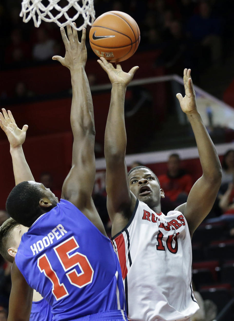 Rutgers' Junior Etou, of Republic of Congo, (10) takes a shot past St. Francis Brooklyn's Chris Hooper (15) during the first half of an NCAA college basketball game Sunday, Nov. 23, 2014, in Piscataway, N.J. (AP Photo/Mel Evans)