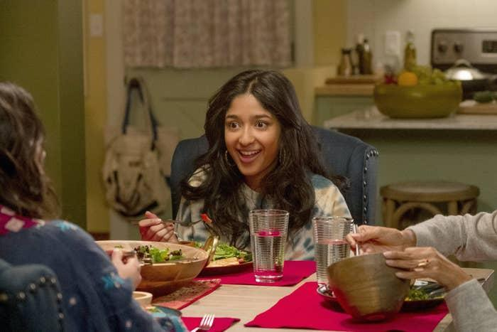 Maitreyi's character eating at the dinner table