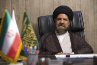 FILE - In this Aug. 3, 2016 file photo, Ayatollah Hashem Bathaei Golpayegani, a member of Iran's Assembly of Experts, speaks in his office, in Tehran, Iran. On March 16, 2020, he died as a result of the COVID-19 coronavirus. (Hossein Razaqnejad/Mehr News Agency via AP)