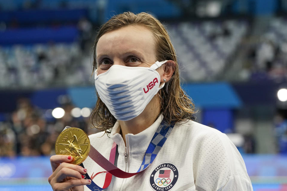 Kathleen Ledecky, of United States, poses after winning the gold medal in the women's 800-meter freestyle final at the 2020 Summer Olympics, Saturday, July 31, 2021, in Tokyo, Japan. (AP Photo/Jae C. Hong)