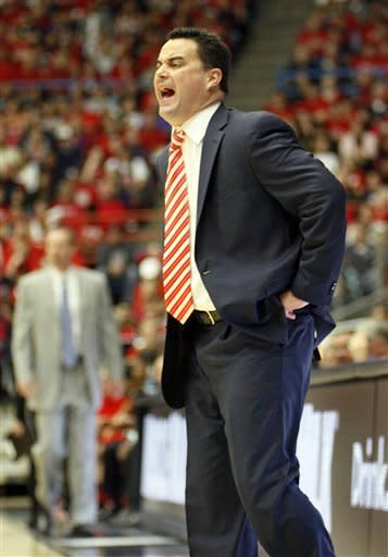 Arizona head coach Sean Miller yells a play out at his team during the second half of an NCAA college basketball game against Utah at McKale Center in Tucson, Ariz., Saturday, Jan. 5, 2013. (AP Photo/Wily Low)