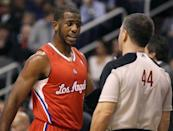 Los Angeles Clippers' Chris Paul, left, discusses a non-call against the Phoenix Suns with official Eli Roe during the first half of an NBA basketball game Sunday, Dec. 23, 2012, in Phoenix. (AP Photo/Ralph Freso)