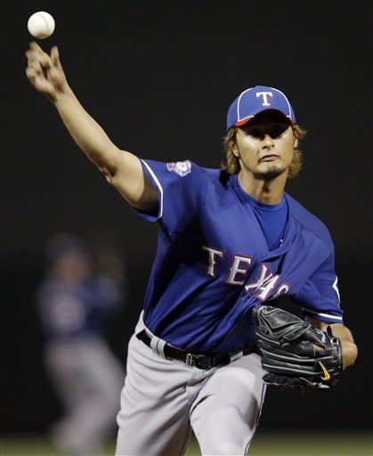 Texas Rangers starting pitcher Yu Darvish throws to the Colorado Rockies during the first inning of a spring training baseball game on Friday, March 30, 2012, in Scottsdale, Ariz. (AP Photo/Marcio Jose Sanchez)