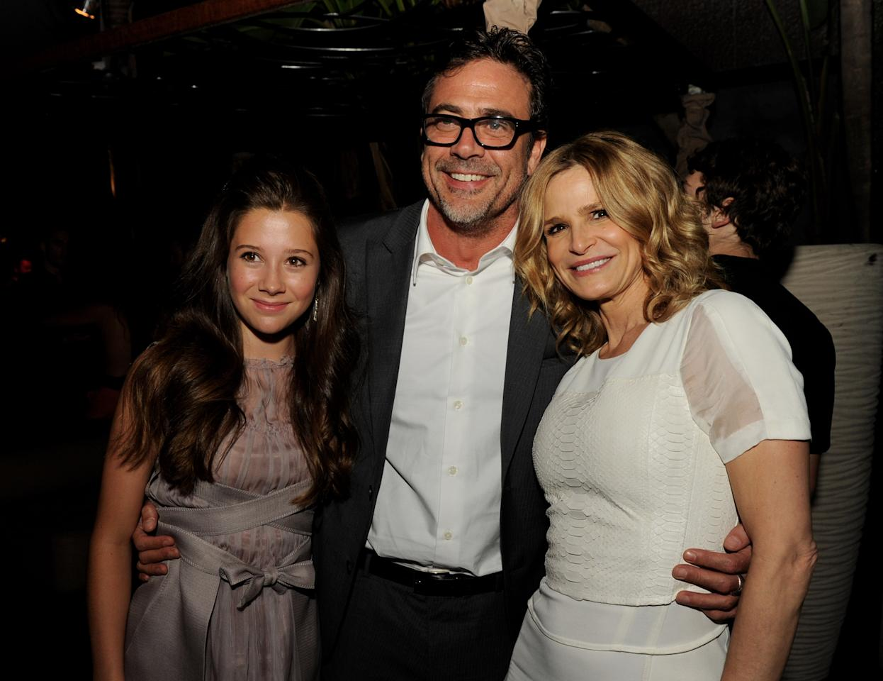 "LOS ANGELES, CA - AUGUST 28:  (L-R) Actors Natasha Calis, Jeffrey Dean Morgan and Kyra Sedgwick pose at the after party for the premiere of Lionsgate Films' ""The Possession"" at Lure on August 28, 2012 in Los Angeles, California.  (Photo by Kevin Winter/Getty Images)"