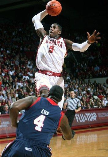 Alabama forward Tony Mitchell (5) takes the ball to the basket as Mississippi's Demarco Cox (4) attempts to block during the first half of an NCAA college basketball game in Tuscaloosa, Ala., Saturday, Feb. 4, 2012. (AP Photo/Tuscaloosa News, Michelle Lepianka) Carter)