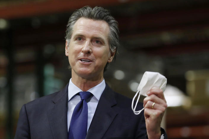 In this June 26, 2020, file photo, California Governor Gavin Newsom holds a face mask during a news conference in Rancho Cordova, California. / Credit: Rich Pedroncelli / AP