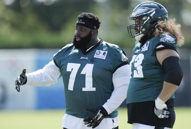 Philadelphia Eagles offensive tackle Jason Peters (71) talks to teammate Isaac Seumalo during an NFL football training camp practice in Philadelphia, Monday, Aug. 17, 2020. (Yong Kim/Pool Photo via AP)