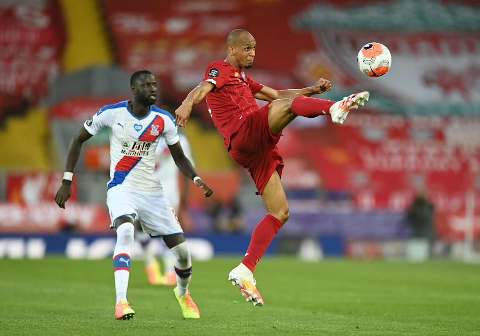 Liverpool's Fabinho (right) in action with Crystal Palace's Cheikhou Kouyate.