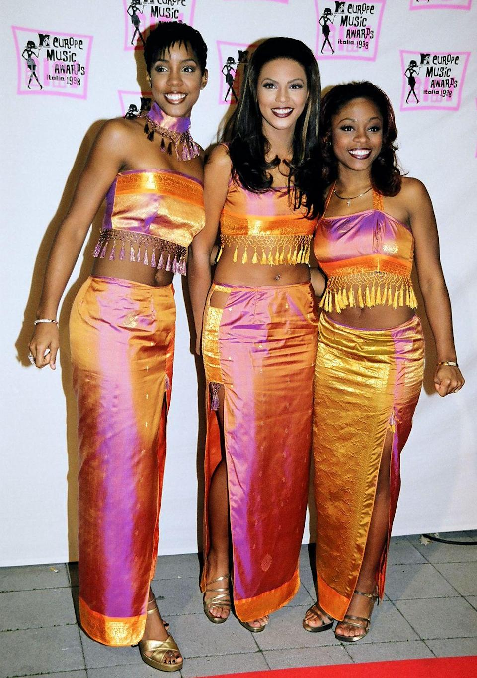 <p>At the European Music Awards, the girl group (pre–Michelle Williams) coordinated in ombré pink-and-orange two-pieces. Clearly, fringed crop tops and maxi skirts were very much A Thing. </p>