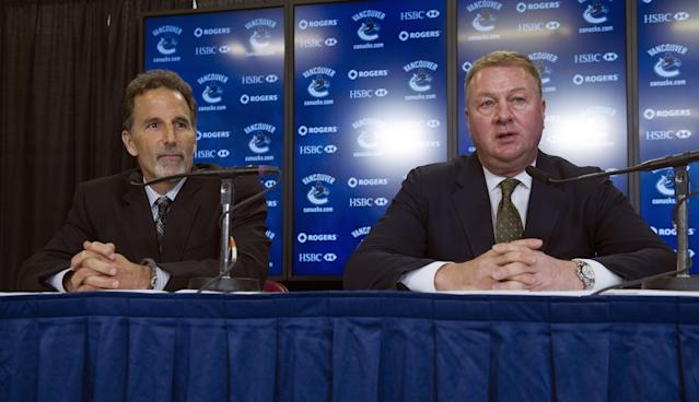 VANCOUVER, CANADA - JUNE 25: Vancouver Canucks General Manager Mike Gillis (R) introduces head coach John Tortorella during a press conference, June 25, 2013 at Rogers Arena in Vancouver, British Columbia, Canada. (Photo by Rich Lam/Getty Images)