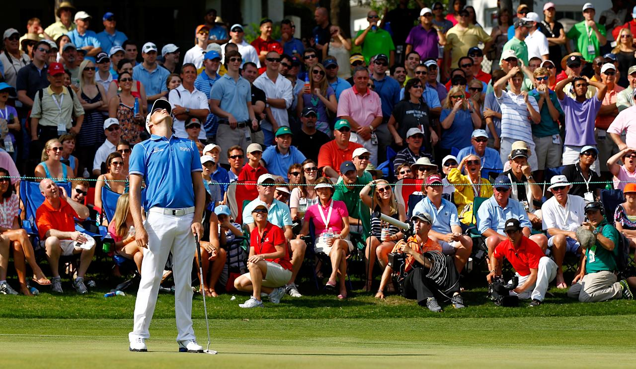 CHARLOTTE, NC - MAY 06:  Nick Watney of the United States reacts to his putt on the 15th green during the final round of the Wells Fargo Championship at the Quail Hollow Club on May 6, 2012 in Charlotte, North Carolina.  (Photo by Mike Ehrmann/Getty Images)