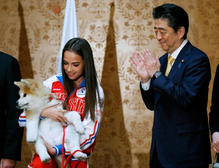Japanese Prime Minister Shinzo Abe helped present Russian figure skating gold medallist Alina Zagitova with an Akita puppy    puppy named Masaru presented by  Japanese Prime Minister Shinzo Abe (R) in Moscow on May 26, 2018 during Abe's official visit to Russia