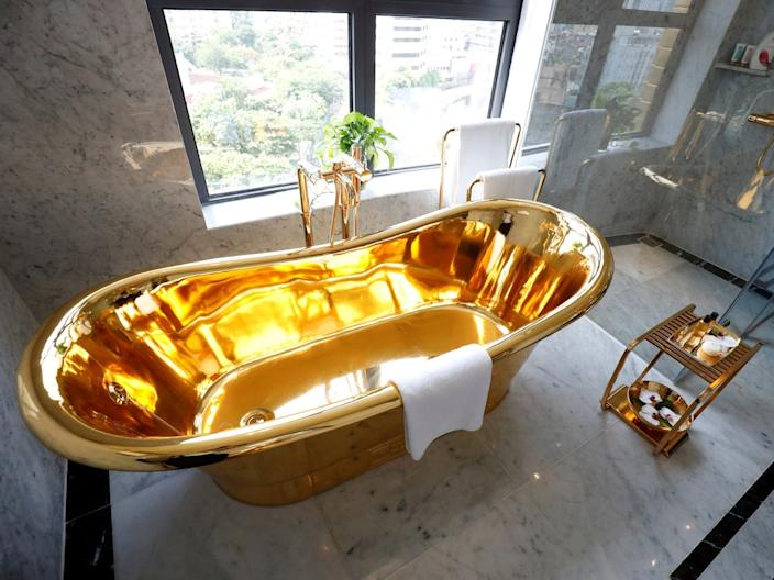 A gold-plated bathtub is seen in the newly-inaugurated Dolce Hanoi Golden Lake luxury hotel in Hanoi, Vietnam, on July 2, 2020.