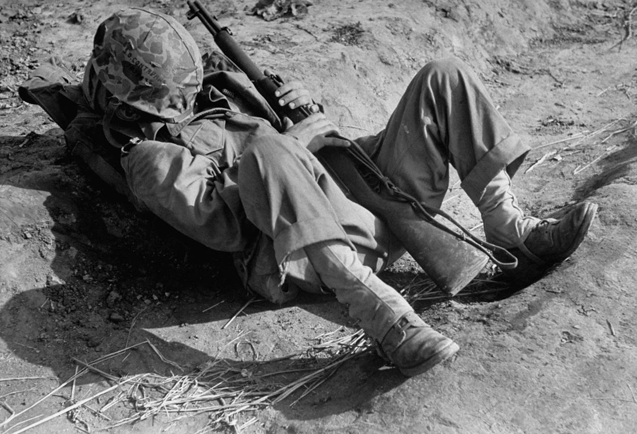 Not originally published in LIFE. An American military man takes a nap, Korea, 1951. Carl Mydans—Time & Life Pictures/Getty Images