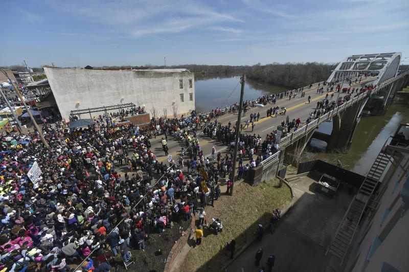 FILE - In this Sunday, March 8, 2015, file photo, crowds gather before a symbolic walk across the Edmund Pettus Bridge, in Selma, Ala. Some residents in the landmark civil rights city of Selma, Alabama, are among the critics of a bid to rename the historic bridge where voting rights marchers were beaten in 1965. (AP Photo/Mike Stewart, File)