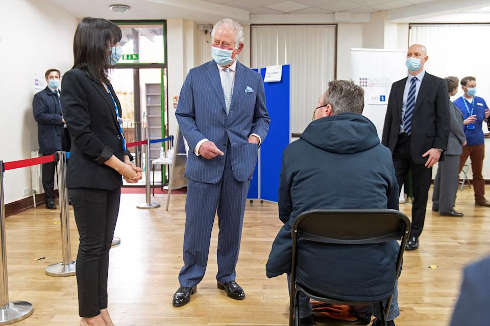 Britain's Prince Charles, Prince of Wales (2L) wearing a face covering, visit a temporary Covid-19 vaccination centre at Finsbury Park Mosque in east London on March 16, 2021. (Photo by Geoff Pugh / POOL / AFP) (Photo by GEOFF PUGH/POOL/AFP via Getty Images)