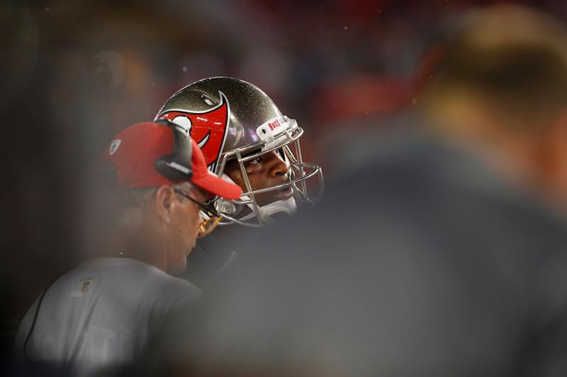 Quarterback Jameis Winston, pictured with head coach Dirk Koetter, will reportedly be suspended three games. (AP)