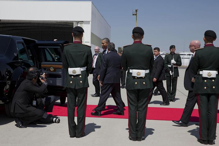 """President Barack Obama, center, walks through an honor guard on arrival at Licenciado Adolfo Lopez Mateos International Airport in Toluca, Mexico, Wednesday, Feb. 19, 2014, to participate in the seventh trilateral North American Leaders Summit Meeting with Canadian Prime Minister Stephen Harper and Mexican President Enrique Peña Nieto. This year's theme is """"North American Competitiveness."""" (AP Photo/Jacquelyn Martin)"""
