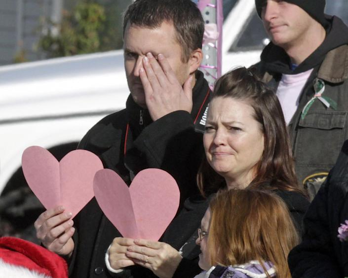 Mourners line the street as a hurst carrying Emilie Parker drives by following funeral services for the 6-year old Connecticut elementary shooting victim, Saturday, Dec. 22, 2012, in Ogden, Utah. Emilie, whose family has Ogden roots, was one of 20 children and six adult victims killed in a Dec. 14 mass shooting at Sandy Hook Elementary in Newtown, Conn. (AP Photo/Rick Bowmer)