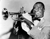 """<p>While he's probably best known for having one of the most distinctive voice in music, Louis Armstrong was also one of the best trumpeters of all time. He was expressionistic and skilled beyond belief, influencing jazz music to move from group improvisation to solo performances. Armstrong was active for nearly 60 years, and is considered to be one of the first black musicians whose popularity <a href=""""http://www.npr.org/templates/story/story.php?storyId=6524506"""" rel=""""nofollow noopener"""" target=""""_blank"""" data-ylk=""""slk:transcended the"""" class=""""link rapid-noclick-resp"""">transcended the </a>racial divisions that gripped the earlier half of the 20th century. He also had an incredibly dapper style, typically sporting a bow tie and pocket square when he performed. <i>(Photo: Getty Images)</i></p>"""