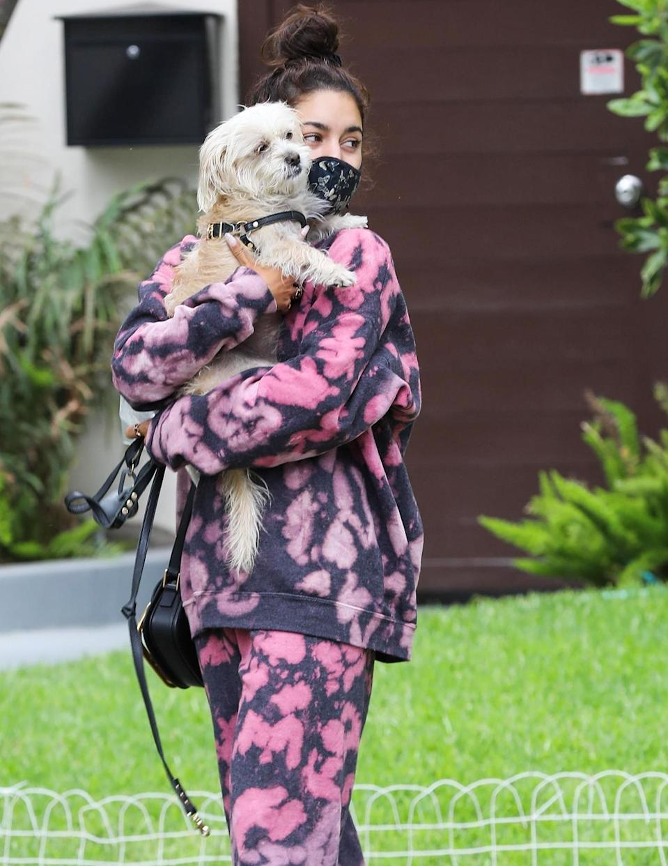 <p>Vanessa Hudgens and her pooch make their way through Beverly Hills after visiting a friend on Wednesday.</p>