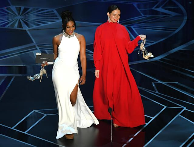 Actors Tiffany Haddish (left) and Maya Rudolph walk onstage during the 90th Annual Academy Awards. (Kevin Winter via Getty Images)
